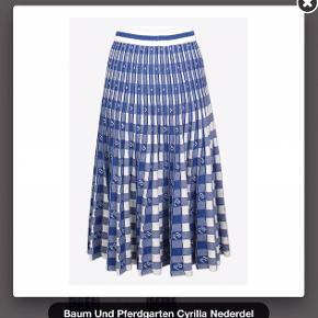 Smuk strik nederdel fra baum med glimmertråd i Ny pris 1600kr