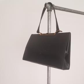Fed retro taske  Bemærkning: den ende ram skal lige have en stigning!  Har kun brugt den 1 gang, har selv købt den i en genbrug til 150kr:)