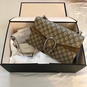 Gucci Dionysus Small  Sælger min Dionysus taske da jeg ikke får den brugt.   Tasken er brugt meget få gange, så den fremstår som ny. Dustbag, æske og kvittering medfølger.   Købt i Gucci Hamborg for ca. 12.500,- Mindstepris: 9500,- * venligst respekter prisen! Skambud ignoreres!  Bytter ikke!