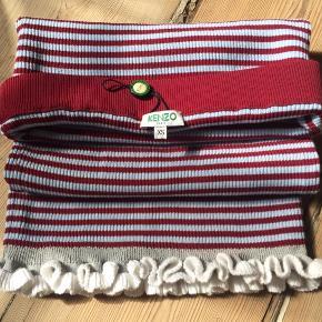 Lyseblå og bourdeu stribet nederdel fra Kenzo. angivet Str. Xs,  men da materialet er meget strech, nok mere en str. S/ måske str.m.  Aldrig brugt. Billeder vedlagt er af tilsvarende model men i andre farver.