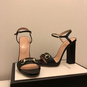 Gucci Princetown Horsebit Black Leather Block Heel Sandals  Black soft leather, block heel  Made in Italy Size Italian 39 (Regular 39) Insole 25.6 cms, heel 12 cm.  Worn once (but inside), see photos of soles, with 2x individual dustbags, and box  Very comfortable, stylish and classic model  Packaging: Dustbag, Shoe box  Original price: 4800 DKK
