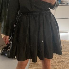 Designer dress (MK Drama Queen) in black leather. Fantastic for going out and pairs well with a pair of black boots of almost any type.