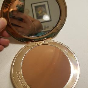 "Airbrush bronzer for face and body.   I farven ""Tan"""