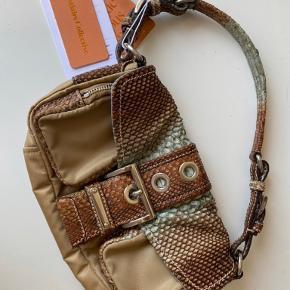 Super smuk 90'er look prada håndtaske købt på Vestiaire collective. Aldrig brugt!