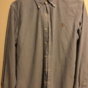 Oxford lyseblå Ralph Lauren skjorte, str M., slim fit. Meget fin stand.