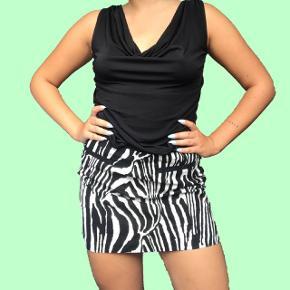 Zebra nederdel  Str. 40 150 kr Sender med DAO Bytter ikke Køber betaler fragten
