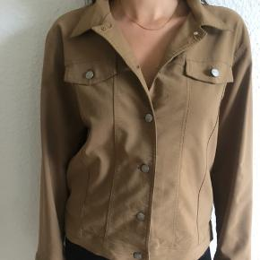 Warm brown/beige thin jacket from brand called Support. Size M. Synthetic material. Not worn but missing tag.
