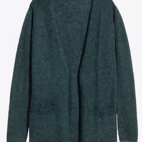Dark bottle green cardigan. It's mohair and wool blend in size xs, fits size small too.