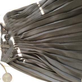 A formet nederdel med plis