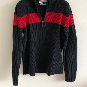 Tommy Hilfiger   Vintage knitted sweater with high-neck and half zipper.  Used but still in good condition.  Size: XL (fits XS-M) Depending on how loose you want.  I'm a size XS-S and wearing it. (See photos)