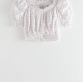 Virkelig fin bluse top med striber fra other stories.   Har den også i kjole til salg