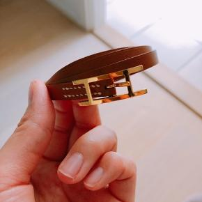 Hermes Hapi 3 triple tour leather bracelet in gold leather with gold hardware. In perfect condition.   Comes with leather pouch and original box. No receipt available as it was a gift. Originally purchased from Hermes store in Copenhagen.