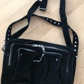 Fin sort ruskindstaske fra Nunoo. Brugt to gange så den er så god som ny