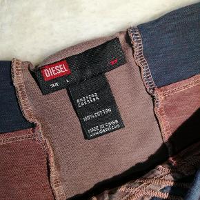 T-shirt fra Diesel. Den har ingen regn på at være blevet brugt.