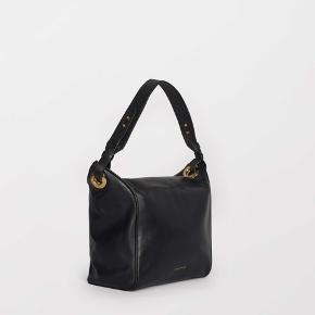 New collection , never worn with tag on. Shoulder bag in premium leather Contrasting smooth and grainy textures Italian hardware Decorative eyelet details Inside features one zipped pocket and one open pocket Size: 20 x 25 x 14 cm