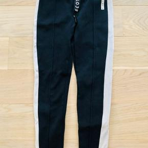 Stretchy sweatpants with white sides