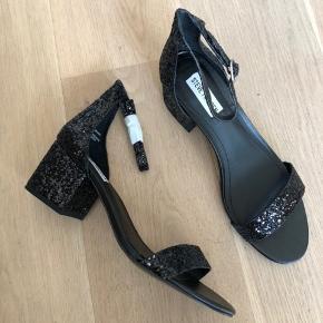 Steve Madden new with box black glitter sandal heels.   Heel height 5.5cm. Never worn.