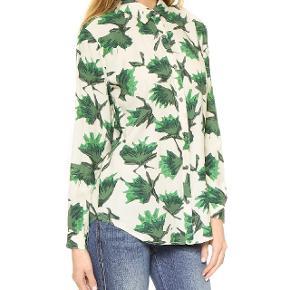 Fin blød cremefarvet skjorte med grønne blade. Modellen hedder 'San Pedro shirt'. Brugt men i fin stand. Sælges fordi jeg ikke får den brugt. Kan afhentes på Nørrebro.