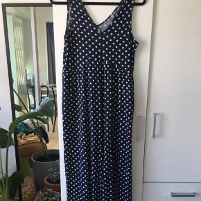 Navy/white polka dot jumpsuit. This is the most comfortable thing you'll ever wear :) Perfect for lounging or traveling!