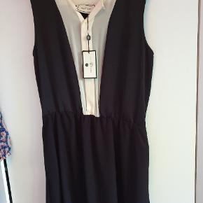 Flot klassisk kjole fra Malene Birger. Aldrig brugt og stadig med tags.
