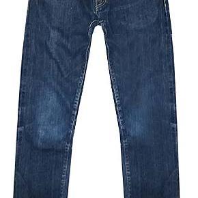 Mørkeblå Carhartt jeans i str 30/32 brugt men i fin stand