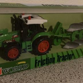 Traktor med plov til traktor elskeren.   Den er ny og i ubrudt emballage   Nypris: 249
