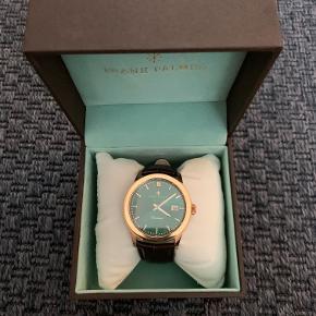 Frank Palmer, ur, med butterfly lås,  Uret har jeg brugt få gang ellers har det været i sin case. Dog er batteriet løbet tør, så den skal skiftes.