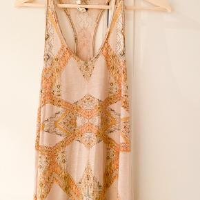 Free people festival dress. Racer back with asymmetric hem. Never used. Polyester cotton blend.