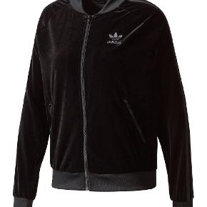 Fed velour track jacket.  Giv et bud