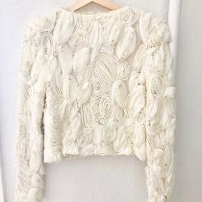 Vintage jakke, str. s, købt i Hong Kong. Der er stretch i jakken, så den har et godt fit.