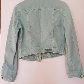 It is a beautiful mint colour and more like size between S and M