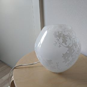 White IKEA lamp with flower motives. Lightbulb included.
