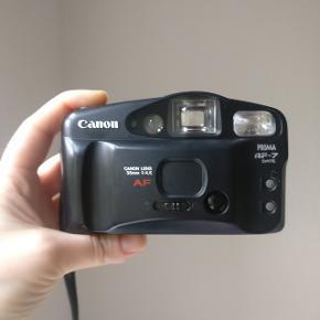 Vintage Canon Prima AF-7 i fortrinlig stand sælges! Begyndervenlig point and shoot analog kamera til 35 mm film. Jeg har selv brugt kameraet og det producerer fine billeder som vist i annoncen. Med følger et random, lidt slidt, etui, der passer godt til kameraet.