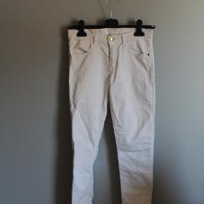 Hvide bukser i str 164.