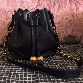 Chanel vintage bucket bag Classic design from Chanel, it is in Lambskin with gold hardware. Used but still in a good condition.