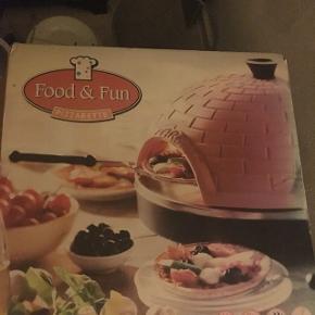 Helt ny pizzaovn til indendørs brug. Har kun været i brug en gang.