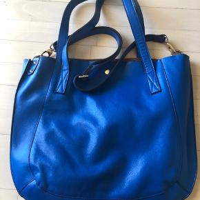 Electric blue leather bag.  Extra soft, has two handles and can be also worn crossbody :D