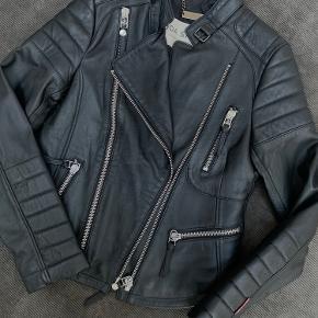 Så god som ny. Mærket hedder Boda Skins. 100% ægte læder.