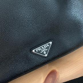 Prada shoulder bag, as new. Have the documents for it.