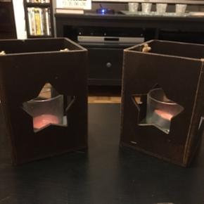 Deux portes bougies en forme d'étoile