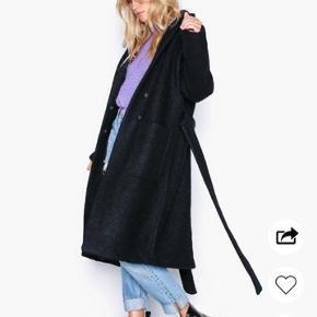 Fin frakke som er brugt én vinter