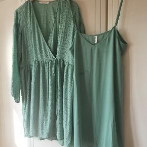 Smuk fin kjole. Den flotteste grønne farve, google style, for st se farven rigtigt.  Brugt en gang. Har den også i mørkblå til samme pris.