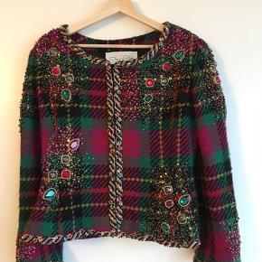 Vintage.  Tweed jakke besat med sten og perler og foret med ægte silke. Oscar de la Renta for Neiman Marcus. Købt i vintage boutique i Californien.