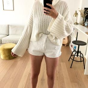 White sweater with turtleneck and long wide sleeves