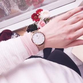 Female wrist watch Size 36mm. Gold IP Stainless Steel. Dial Colour - White. Strap width 16mm. Water proof. Comes with an extra strap in orange :). The back is personalized. New price 1200dkk
