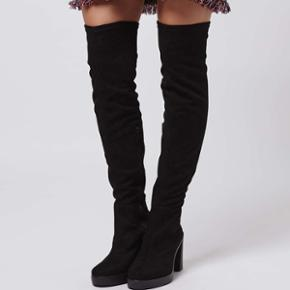Topshop over the knee stretch boots in 38. Heel appx 8cm and is comfortable. Only used once, no marks anywhere, very good condition