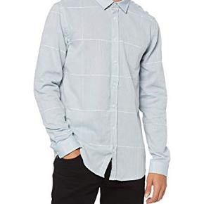 Lækker skjorte i bomuld. Købt for lille.