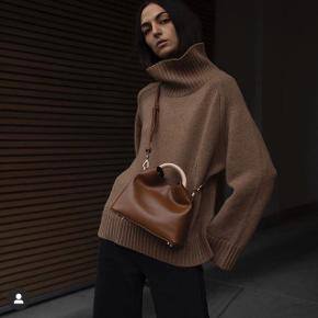 By Malene Birger turtleneck, oversized model in camel colour. A few 'fnugger' which can easily be removed with a machine.