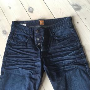 Cowboybukser / denim bukser fra Hugo Boss Orange str. 32/34. Aldrig brugt Kan afhentes eller sendes mod betaling   Der gives mængderabat ved køb af flere varer