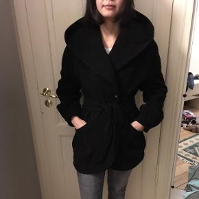 64% wool 31% viscose 5% lycra Coat with hood and belt  Has a button to cover the neck   As new Fits sizes XS-M  Price negotiable Only one in whole Europe